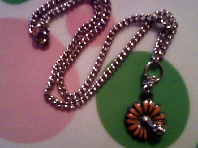 Silver Ladybug on a Orange Flower Necklace.