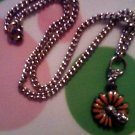 Silver Ladybug on a Orange Flower Necklace.