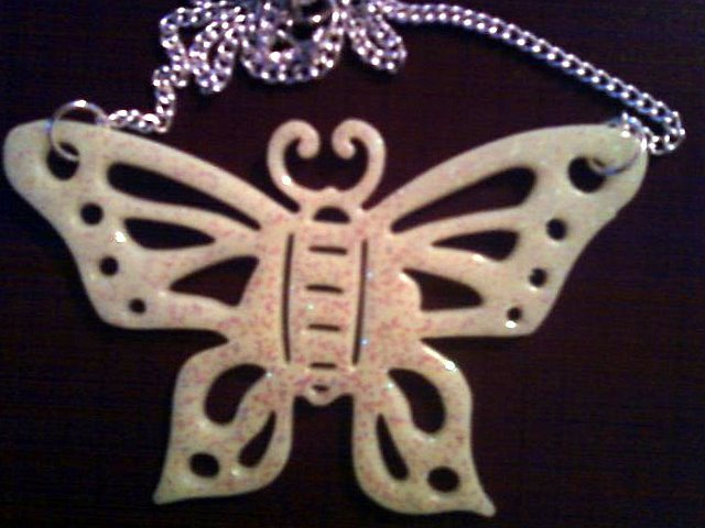 Large Glitter Glow in the Dark Butterfly Necklace.