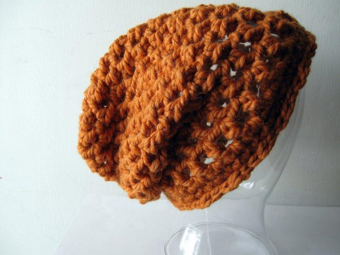 the slacker beanie hat in pumpkin orange.
