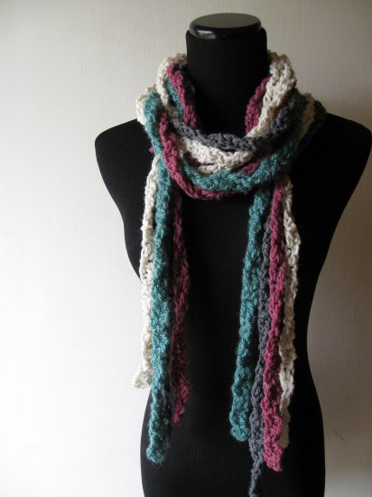 the twisted colors scarf in gray, teal, cream, and purple.