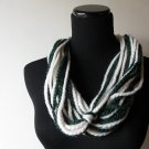 the big knot scarf in cream and green.