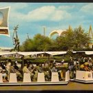 1964 NEW YORK WORLDS FAIR POSTCARD GLIDE-A-RIDE TRAINS WITH ROCKET THROWER IN BACKGROUND