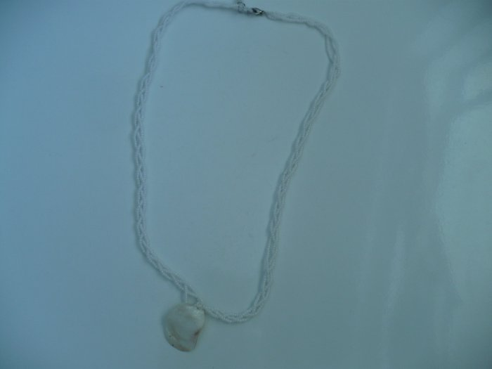 Full length necklace made with a sea shell and white glass seed beads
