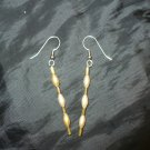 gold colored these earrings are made of small pearl like beads and glass seed beads