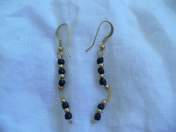 gold plated brass earrings with round black beads.