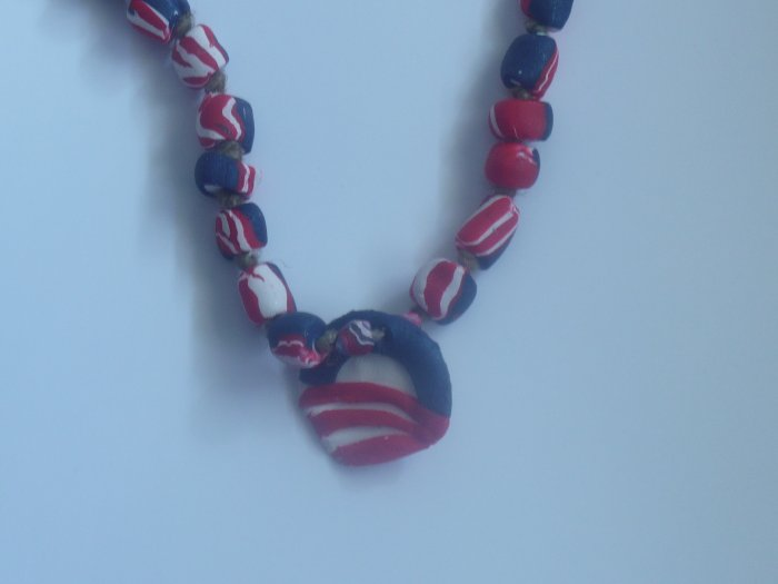red, white ,and blue necklace with Barack Obama logo.