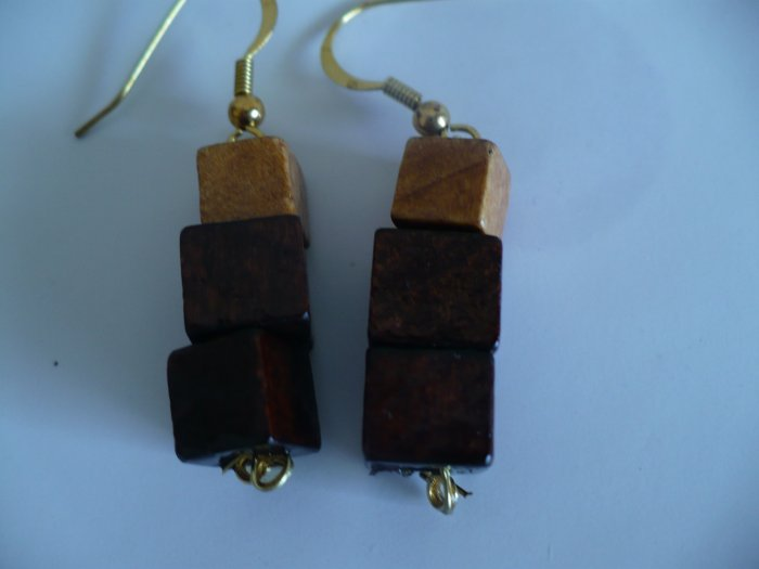 Earrings made with cube shaped wooden beads