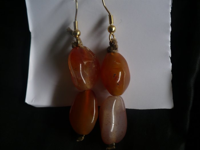 earrings made with large orange glass beads