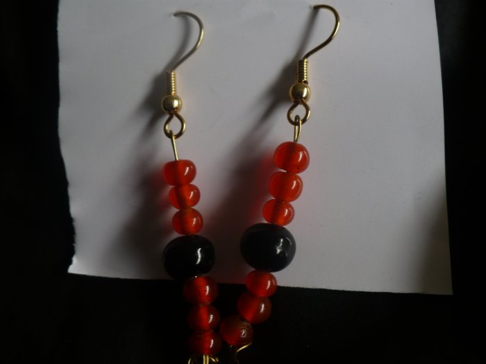Earrings made with orange and black glass beads