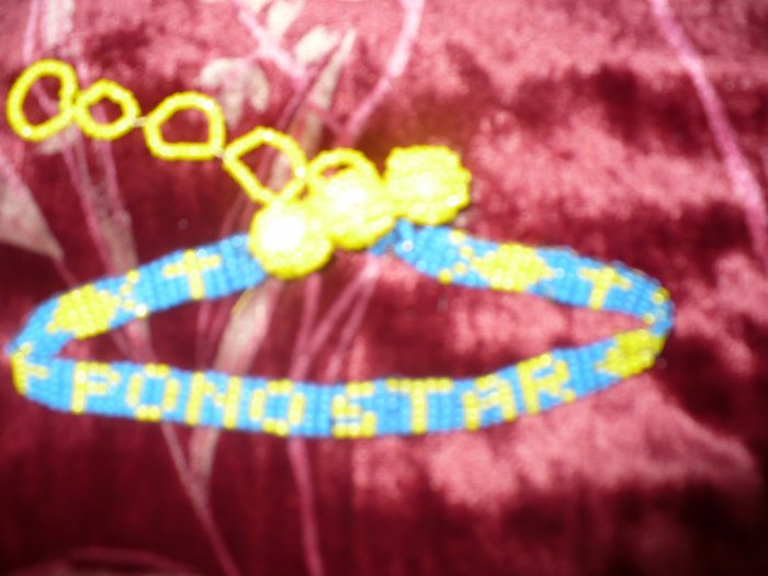 blue and yellow choker that spells pono star