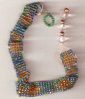bracelet with gold colored fish and blue-green background