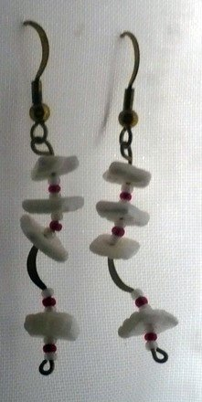 earrings made with shell white shell beads and red seed beads with gold plated ear wires.