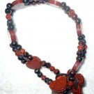 red and black wooden heart anklet
