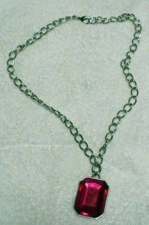 necklace made with large fuscia cut faceted glass