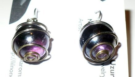 earrings made with purple marbles.