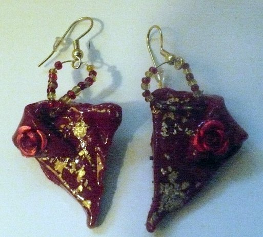 red earrings with gold flecks and a rose