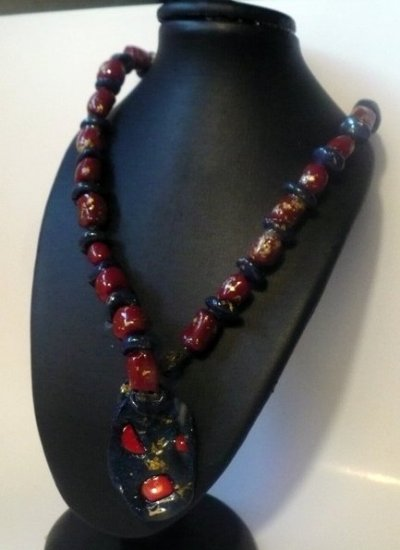 red,blue and gold necklace with blue disk and semi-precious stones