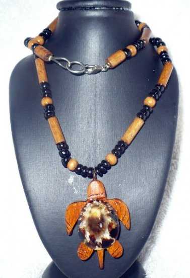 Wooden beaded necklace with turtle shaped pendant made of wood and shell.