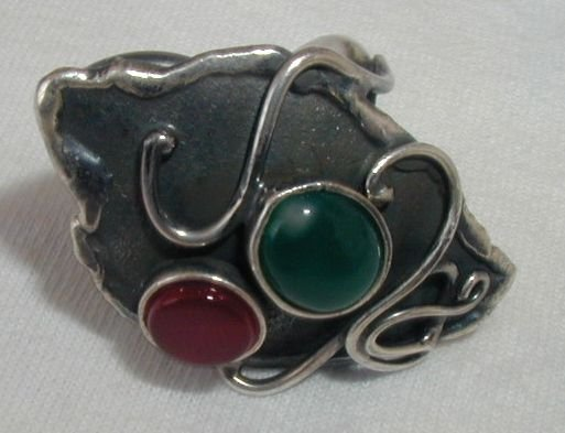 Black silver ring with red and green