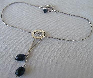 silver and black zircon