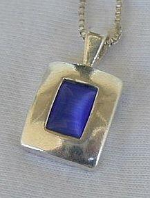 Mini blue cat eye pendant