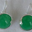 Shiny green round earrings