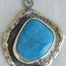 Turquoise pressed stone pendant