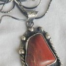Red loam colored stone pendant