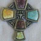 A beautiful artistic metal cross with stones,