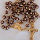 Artificial brown colored pearls beads rosary .