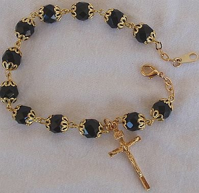 Black glass beads bracelet with golden cross