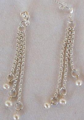 White pearls dangling earrings