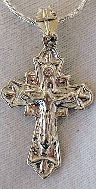 Catholic shiny silver pendant