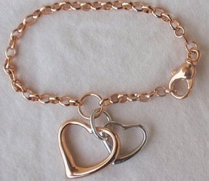 Silver and cooper hearts bracelet