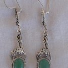 Dangling green earrings