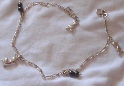 Poult and black silver anklet
