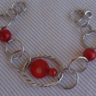 Rounds silver bracelet with corl colored