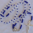 A blue and white rosary beads