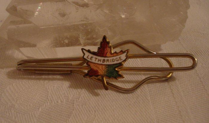 Lethbridge Alberta souvenir tie clip with cloisonne maple leaf vintage 1138vf