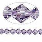 6mm Swarovski Crystal *tanzanite* with silver spacers bracelet
