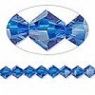 8mm swarovski crystal *capri blue* with gold spacer 7 inch bracelet