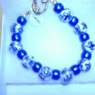 Asain style beads with blue spacers Clamp bracelet