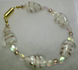 clear stone with purple strips ....