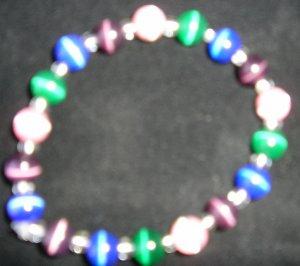 stretchy pink, green, blue & purple cats eye beaded bracelet