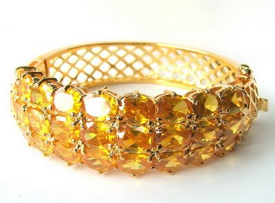 14k yellow gold Yellow sapphire bangle heated stone
