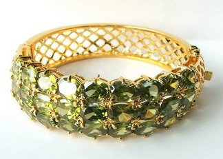 14k yellow gold Green sapphire bangle heated stone