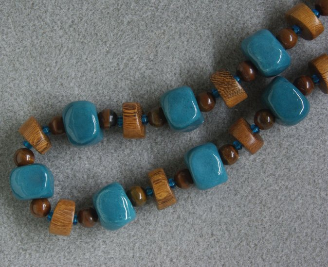 """""""Wood-Teal"""" necklace with wood, ceramic, Czech glass and tiger iron beads and copper"""
