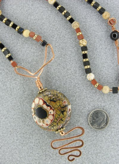"""""""Asymmetrical Underground Flower"""" necklace and earring set with polymer clay, gemstones and copper"""