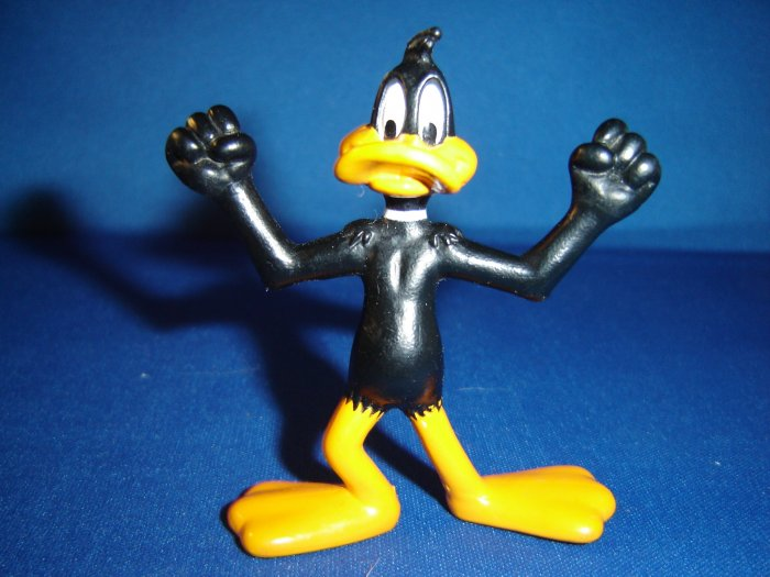 1991 Looney Tunes PVC Daffy Duck Figure Making a Muscle Pose
